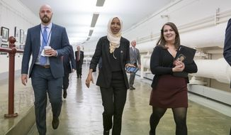 """Rep. Ilhan Omar, D-Minn., walks to the chamber Thursday, March 7, 2019, on Capitol Hill in Washington, as the House was preparing to vote on a resolution to speak out against, as Speaker of the House Nancy Pelosi said, """"anti-Semitism, anti-Islamophobia, anti-white supremacy and all the forms that it takes,"""" an action sparked by remarks from Omar. (AP Photo/J. Scott Applewhite)"""
