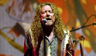 Musician Robert Plant performs in Little Rock, Ark. Thursday July 15, 2010. (AP Photo/Brian Chilson)