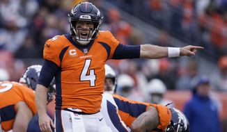 FILE - In this Dec. 30, 2018, file photo, Denver Broncos quarterback Case Keenum calls out to teammates during the first half of the team's NFL football game against the Los Angeles Chargers in Denver. A person with knowledge of the deal tells The Associated Press that the Broncos have agreed to trade Keenum to the Washington Redskins. Speaking on condition of anonymity because the deal cannot be announced until the start of the new league year March 13, the person confirmed that the teams will also swap 2020 draft picks, with Denver receiving a sixth-rounder and Washington a seventh-rounder. (AP Photo/Jack Dempsey, File)