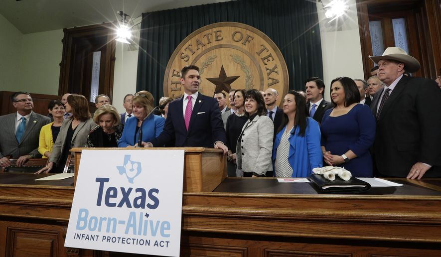 State Rep. Jeff Leach, at podium, stands with fellow lawmakers and guests to talk about the Texas Born-Alive bill, Thursday, March 7, 2019, in Austin, Texas. (AP Photo/Eric Gay)
