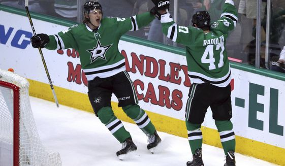 Dallas Stars left wing Roope Hintz (24) celebrates a goal by Dallas Stars right wing Alexander Radulov (47) against the Colorado Avalanche in the second period in an NHL hockey game Thursday, March 7, 2019, in Dallas. (AP Photo/Richard W. Rodriguez)