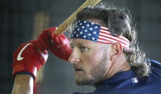 FILE - In this Feb. 17, 2019, file photo, Atlanta Braves' Josh Donaldson takes batting practice during baseball spring training in Lake Buena Vista, Fla. Donaldson is expected to play in his first spring game on Friday, March 8, 2019. The Braves are counting on the former AL MVP to add power to the middle of the lineup. (Curtis Compton/Atlanta Journal-Constitution via AP, File)