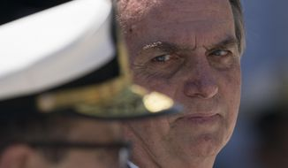 Brazil's President Jair Bolsonaro attends a ceremony marking the 211th anniversary of Brazilian Marine Corps in Rio de Janeiro, Brazil, Thursday, March 7, 2019. (AP Photo/Leo Correa)