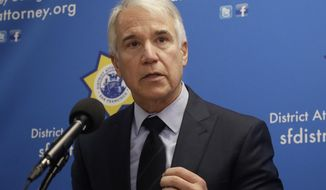 FILE - In this Feb. 21, 2018, file photo, San Francisco District Attorney George Gascon speaks at news conference in San Francisco. A Northern California lawmaker and district attorney are seeking to automatically clear some 8 million criminal convictions eligible for sealing but remain public records. San Francisco District Attorney George Gascon and state Democratic Assemblyman Phil Ting of San Francisco a proposed a bill Thursday, March 7, 2019, to automatically take advantage of an often overlooked California law allowing convicted drunken drivers, burglars and other low-level offenders to seal their records. (AP Photo/Jeff Chiu, File)