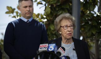 Joined by Newport Harbor High School Principal Sean Boulton, left, Eva Schloss, the stepsister of Anne Frank and a Holocaust survivor, talks to reporters during a news conference Thursday, March 7, 2019, in Newport Beach, Calif. Schloss met Thursday with Southern California high school students who were photographed giving Nazi salutes around a swastika formed by drinking cups at a party. Schloss said the students apologized for their behavior and indicated they didn't realize what it really meant. (AP Photo/Jae C. Hong)