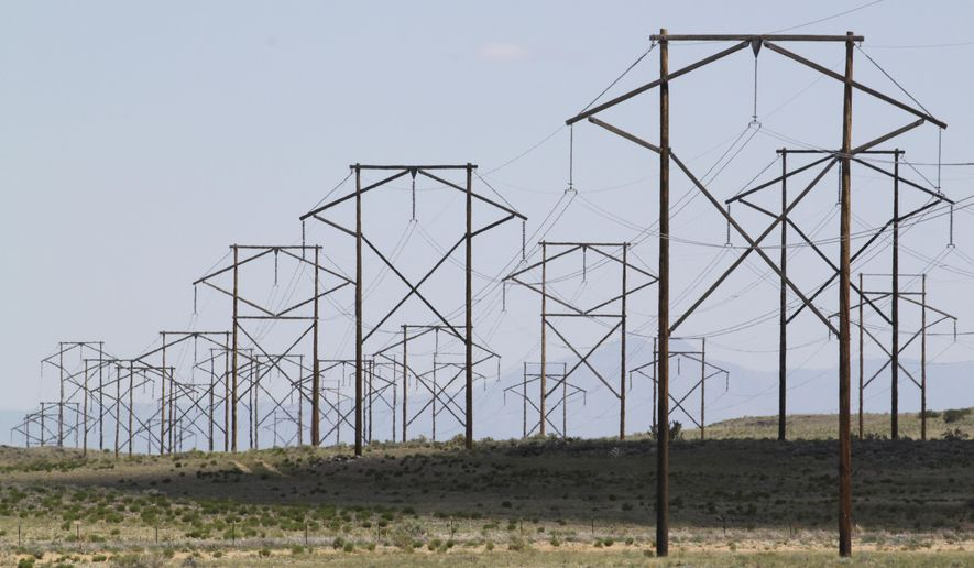 FILE - This May 20, 2012 photo shows one of the major transmission lines that runs to the west of Albuquerque, N.M. New Mexico lawmakers are considering legislation during the 2019 session that sets aggressive new quotas for renewable energy production. (AP Photo/Susan Montoya Bryan, File)