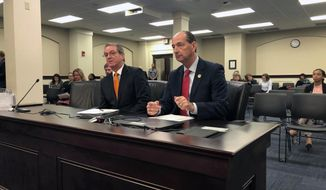 House Speaker David Osborne. left, and House Minority Floor Leader Rocky Adkins testify for a bill that would spare Kentucky lawmakers from having to referee disputed elections involving state legislative candidates,  Thursday, March 7, 2019 in Frankfort, Ky. The bill was advanced by a House committee. (AP Photo/Bruce Schreiner)