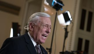 House Majority Leader Steny Hoyer, D-Md., speaks during a television news interview just outside the House Chamber prior a vote on an anti-hate resolution, an action sparked by controversial remarks from freshman Democrat Ilhan Omar, at the Capitol in Washington, Thursday, March 7, 2019. (AP Photo/J. Scott Applewhite)