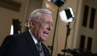 House Majority Leader Steny Hoyer, D-Md., speaks during a television news interview just outside the House Chamber prior a vote on an anti-hate resolution, an action sparked by controversial remarks from freshman Democrat Ilhan Omar, at the Capitol in Washington, Thursday, March 7, 2019. (AP Photo/J. Scott Applewhite) ** FILE **