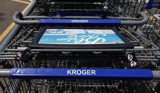 FILE- This June 15, 2017, file photo, shows Kroger grocery store shopping carts with the store's name in Flowood, Miss. Kroger reports financial results Thursday, March 7, 2019. (AP Photo/Rogelio V. Solis, File)