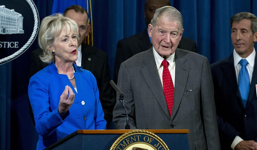 Lynda Webster accompanied by her husband former FBI Director and the CIA Director William Webster, who were targeted by a man who peddled a lottery scam over phone calls and emails, speaks during a news conference to address elder financial exploitation and law enforcement actions, at Department of Justice in Washington, Thursday, March 7, 2019. (AP Photo/Jose Luis Magana) ** FILE **