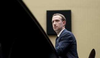 In this April 11, 2018, file photo, Facebook CEO Mark Zuckerberg listens to a question as he testifies before a House Energy and Commerce hearing on Capitol Hill in Washington, about the use of Facebook data to target American voters in the 2016 election and data privacy. (AP Photo/Andrew Harnik)
