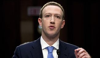 In this April 10, 2018, file photo, Facebook CEO Mark Zuckerberg testifies before a joint hearing of the Commerce and Judiciary Committees on Capitol Hill in Washington, about the use of Facebook data to target American voters in the 2016 election. Zuckerberg said Facebook will start to emphasize new privacy-shielding messaging services, a shift apparently intended to blunt both criticism of the company's data handling and potential antitrust action. (AP Photo/Andrew Harnik, File)