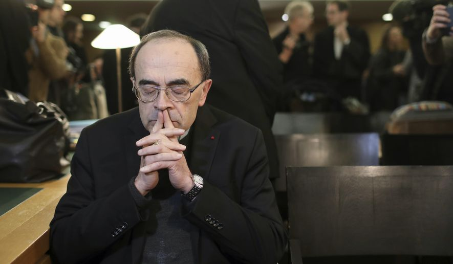 In this Jan. 7, 2019, file photo, French Cardinal Philippe Barbarin waits for the start of his trial at the Lyon courthouse, central France. A French court has found top Catholic official Cardinal Philippe Barbarin guilty for failing to report to justice accusations against a pedophile priest. In a surprise decision Thursday, March 7, 2019, in France's most important church sex abuse trial, the Lyon court handed Barbarin a six-month suspended prison sentence for not reporting the facts in the period between July 2014 and June 2015. (AP Photo/Laurent Cipriani, File)