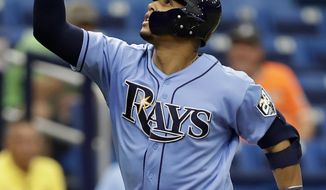 FILE - In this Sept. 9, 2018, file photo, Tampa Bay Rays' Carlos Gomez celebrates his home run off Baltimore Orioles starting pitcher Jimmy Yacabonis during the sixth inning of a baseball game, in St. Petersburg, Fla. Carlos Gomez is back with the Mets, 3 1/2 years after a trade that would have sent him from Milwaukee to New York fell through. (AP Photo/Chris O'Meara, File)
