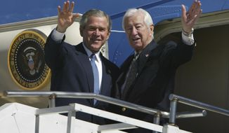 FILE - In this March 8, 2004, file photo, then President Bush, left, waves with Rep. Ralph Hall, R-Texas, right, as they step off Air Force One upon Bush's arrival in Dallas. Former Rep. Hall, the oldest-ever member of the U.S. House, has died at age 95. (AP Photo/Charles Dharapak, File)