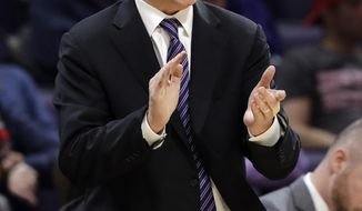 Northwestern coach Chris Collins cheers on the team during the second half of an NCAA college basketball game against Ohio State, Wednesday, March 6, 2019, in Evanston, Ill. (AP Photo/Nam Y. Huh)