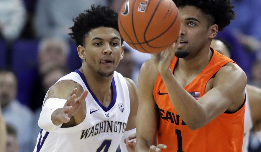 Oregon State guard Stephen Thompson Jr. (1) gets a pass off next to Washington guard Matisse Thybulle (4) during the first half of an NCAA college basketball game Wednesday, March 6, 2019 in Seattle. (AP Photo/Ted S. Warren)