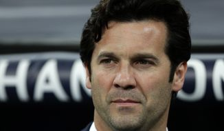 Real coach Santiago Solari arrives at the pitch ahead of the Champions League soccer match between Real Madrid and Ajax at the Santiago Bernabeu stadium in Madrid, Spain, Tuesday, March 5, 2019. (AP Photo/Manu Fernandez)