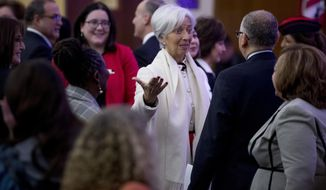 International Monetary Fund Managing Director Christine Lagarde, center, speaks with guests following the 2019 International Women of Courage Awards at the Department of State in Washington, Thursday, March 7, 2019. (AP Photo/Andrew Harnik)