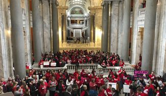 Hundreds of teachers fill the Kentucky Capitol on Thursday, March 7, 2019, in Frankfort, Ky. At least four school districts were forced to close on Thursday because too many teachers had called in sick to protest proposed legislation at state Capitol. (AP Photo/Adam Beam)