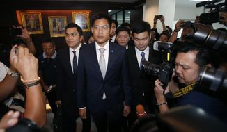 Leader of Thai Raksa Chart party Preechapol Pongpanich, center, leaves Thai Raksa Chart party to Constitutional Court in Bangkok, Thailand, Thursday, March 7, 2019. Thailand's Constitutional Court expected to issue ruling on whether to dissolve the Thai Raksa Chart political party, less than three weeks before long-delayed elections. The Thai Raksa Chart Party has been threatened with dissolution for having nominated King Maha Vajiralongkorn's sister as its candidate for prime minister, an unprecedented move that the monarch declared was inappropriate and unconstitutional. (AP Photo/Sakchai Lalit)