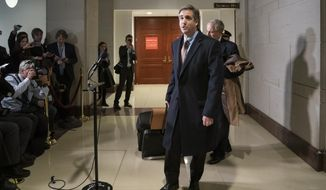 "Michael Cohen, President Donald Trump's former lawyer, tells reporters he will ""continue to cooperate"" with investigators following a full day of testimony with the House Intelligence Committee as he prepares for a three-year prison sentence for lying to Congress and other charges, at the Capitol in Washington, Wednesday, March 6, 2019. (AP Photo/J. Scott Applewhite)"