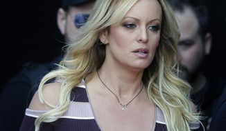"FILE - In this Oct. 11, 2018, file photo, adult film actress Stormy Daniels arrives at the adult entertainment fair ""Venus"" in Berlin. A federal judge has thrown out a lawsuit against President Donald Trump by porn actress Stormy Daniels that sought to tear up a hush-money settlement about their alleged affair. Judge S. James Otero ruled Thursday, March 7, 2019, in U.S. District Court that the suit was irrelevant after Trump and his former personal lawyer agreed to rescind a nondisclosure agreement Daniels signed in exchange for a $130,000 payment.  (AP Photo/Markus Schreiber, File)"