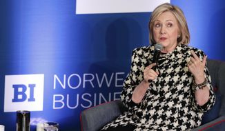 Former US Secretary of State, Hillary Rodham Clinton, attends international conference focusing on gender equality at BI Norwegian Business School, in Oslo, Friday March 8, 2019. (Berit Roald, NTB scanpix via AP)