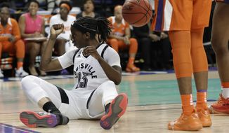 Louisville's Jazmine Jones (23) reacts after making a basket and being fouled during the first half of an NCAA college basketball game against Clemson in the Atlantic Coast Conference women's tournament in Greensboro, N.C., Friday, March 8, 2019. (AP Photo/Chuck Burton)