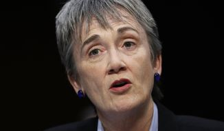 FILE - In this Dec. 6, 2017, file photo, Air Force Secretary Heather Wilson is testifies during a Senate Judiciary Committee hearing on Capitol Hill in Washington. Officials say Wilson has resigned.  (AP Photo/Carolyn Kaster, File)