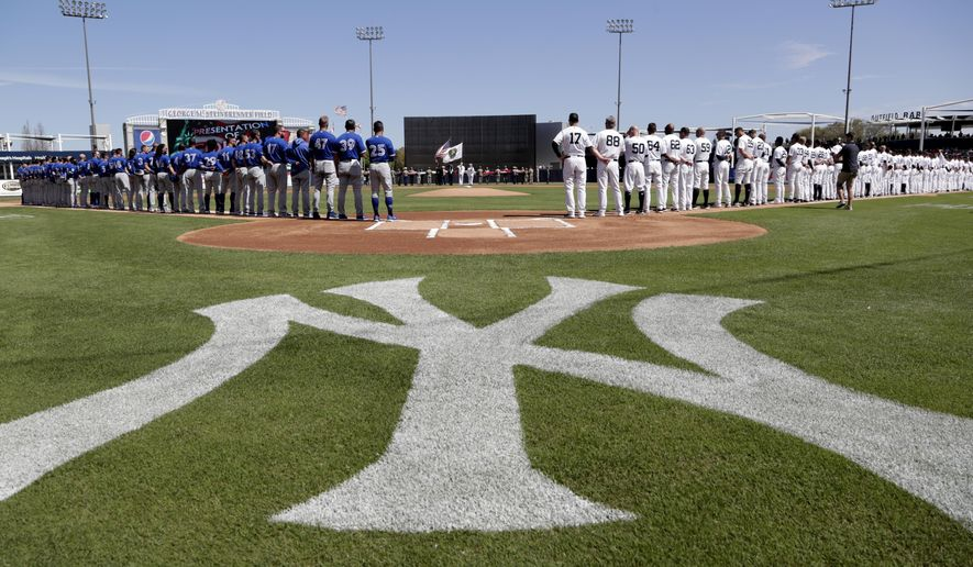The Toronto Blue Jays and New York Yankees stand for their national anthems before a spring training baseball game, Monday, Feb. 25, 2019, in Tampa, Fla. (AP Photo/Lynne Sladky)