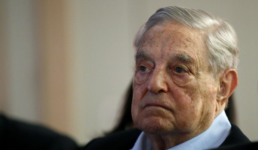 "In this May 29, 2018, file photo George Soros, founder and chairman of the Open Society Foundations, listens to the conference after his speech titled ""How to save the European Union"" as he attends the European Council On Foreign Relations Annual Council Meeting in Paris. (AP Photo/Francois Mori) ** FILE **"