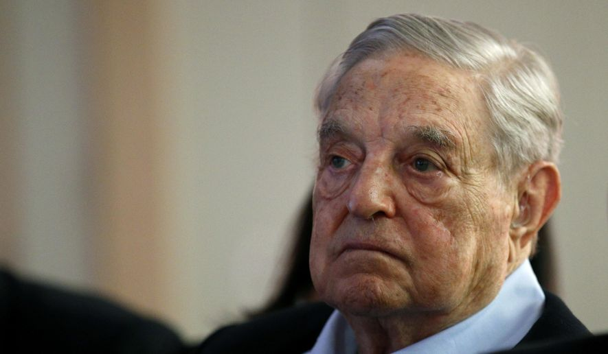 """In this May 29, 2018, file photo George Soros, founder and chairman of the Open Society Foundations, listens to the conference after his speech titled """"How to save the European Union"""" as he attends the European Council On Foreign Relations Annual Council Meeting in Paris. (AP Photo/Francois Mori) ** FILE **"""
