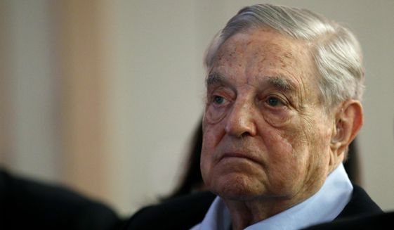 """In this May 29, 2018, file photo, George Soros, founder and chairman of the Open Society Foundations, listens to the conference after his speech titled """"How to save the European Union"""" as he attends the European Council On Foreign Relations Annual Council Meeting in Paris. (AP Photo/Francois Mori) **FILE**"""
