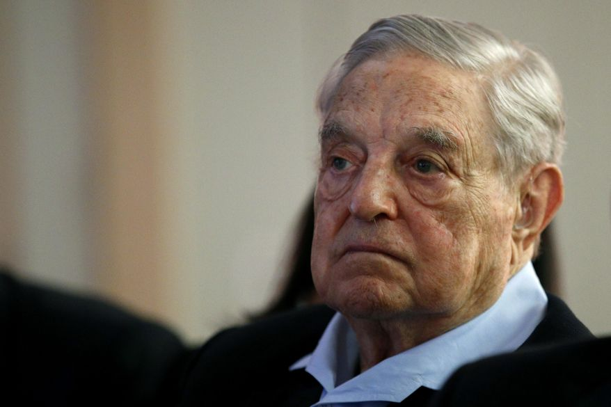 "In this May 29, 2018, file photo, George Soros, founder and chairman of the Open Society Foundations, listens to the conference after his speech titled ""How to save the European Union"" as he attends the European Council On Foreign Relations Annual Council Meeting in Paris. (AP Photo/Francois Mori) **FILE**"