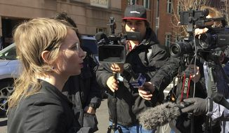 In this Tuesday, March 5, 2019, photo, Chelsea Manning addresses the media outside federal court in Alexandria, Va. The former Army intelligence analyst was ordered to jail Friday, March 8, 2019, for refusing to testify to a Virginia grand jury investigating Wikileaks. (AP Photo/Matthew Barakat)