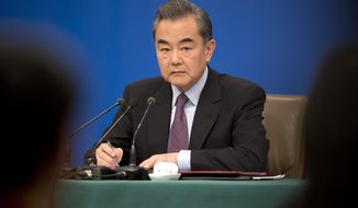 """Chinese Foreign Minister Wang Yi listens to a journalist's question during a press conference on the sidelines of the annual meeting of China's National People's Congress (NPC) in Beijing, Friday, March 8, 2019. The U.S.-North Korea summit in Vietnam last week was an """"important step"""" toward denuclearization on the Korean peninsula, China's foreign minister said Friday. (AP Photo/Mark Schiefelbein)"""