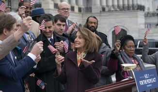 """Speaker of the House Nancy Pelosi, D-Calif., and House Democrats rally ahead of passage of H.R. 1, """"The For the People Act,"""" at the Capitol in Washington, Friday, March 8, 2019. Rep. John Sarbanes, D-Md., the bill's sponsor, stands behind Pelosi at left. The bill aims to expand voting rights, limit partisan gerrymandering, strengthen ethics rules, and limit the influence of private donor money in politics. (AP Photo/J. Scott Applewhite)"""