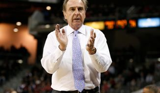 FILE - In this Jan. 24, 2018, file photo, Temple head coach Fran Dunphy cheers his team during the second half of an NCAA college basketball game against Cincinnati in Highland Heights, Ky. Dunphy is ready to call it quits after a nearly 50-year coaching career that includes the last 13 with the Owls. He will coach his final home game on Saturday, March 9, 2019, and remained hopeful the Owls can make the NCAA Tournament. (AP Photo/Gary Landers, File)
