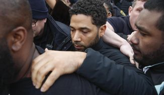 "FILE - In this Feb. 21, 2019 file photo, ""Empire"" actor Jussie Smollett leaves Cook County jail following his release in Chicago. A Cook County grand jury on Friday, March 8, 2019 has indicted Smollett on 16 felony charges after authorities say he falsely told police that he was attacked by two men in Chicago. (AP Photo/Kamil Krzaczynski, File)"
