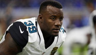 FILE- In this Nov. 20, 2016, file photo, Jacksonville Jaguars free safety Tashaun Gipson stretches before an NFL football game against the Detroit Lions in Detroit. The Jaguars have released defensive tackle Malik Jackson, safety Tashaun Gipson, offensive lineman Jermey Parnell, running back Carlos Hyde and long-snapper Carson Tinker, creating $30 million in salary cap space for 2019, the team announced Friday, March 8, 2019.  (AP Photo/Paul Sancya, File)