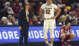 South Carolina head coach Dawn Staley, left, speaks to her player Tyasha Harris during the first half of a women's Southeastern Conference NCAA college basketball tournament game against Arkansas, Friday, March 8, 2019, in Greenville, S.C. (AP Photo/Richard Shiro)