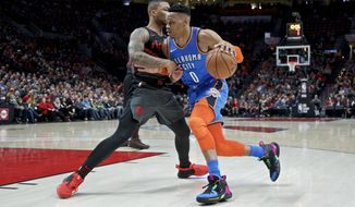 Oklahoma City Thunder guard Russell Westbrook, right, drives Portland Trail Blazers guard Damian Lillard during the first half of an NBA basketball game in Portland, Ore., Thursday, March 7, 2019. (AP Photo/Craig Mitchelldyer)