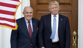 FILE - In this Nov. 20, 2016, file photo, then-President-elect Donald Trump, right, and former New York Mayor Rudy Giuliani pose for photographs as Giuliani arrives at the Trump National Golf Club Bedminster clubhouse in Bedminster, N.J.. (AP Photo/Carolyn Kaster, File) **FILE**