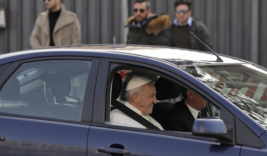 Pope Francis waves as he leaves St. John Lateran Basilica after meeting Roman clergy, in Rome, Thursday, March 7, 2019. (AP Photo/Alessandra Tarantino)