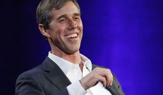 """FILE - In this Tuesday, Feb. 5, 2019 file photo, former Democratic Texas congressman Beto O'Rourke laughs during a live interview with Oprah Winfrey on a Times Square stage at """"SuperSoul Conversations,"""" in New York.  The new Beto O'Rourke documentary, """"Running With Beto,"""" ends with him musing about how to keep the momentum of his 2018 defeat in the Texas Senate race going. O'Rourke himself attended the premiere Saturday, March 9, 2019, at South by Southwest, but he also was coy about his future, repeating only that he'll announce his plans """"soon."""" (AP Photo/Kathy Willens, File)"""