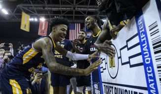 Murray State's Ja Morant (12) puts a Racers sticker on the NCAA tournament ticket board following the team's win over Belmont in an NCAA college basketball game for the Ohio Valley Conference men's tournament championship in Evansville, Ind., Saturday, March 9, 2019. (Sam Owens/Evansville Courier & Press via AP) ** FILE **
