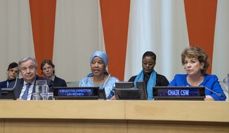 """In this Friday, March 8, 2019 photo provided by the United Nations, Phumzile Mlambo-Ngcuka, third from right, executive director of UN Women, speaks at the United Nations Observance of International Women's Day at the United Nations headquarters. Mlambo-Ngcuka is calling for the revolution in technology to be used to benefit the world's poor and especially women who will not achieve gender equality without """"the giant leap that 21st century innovations can bring."""" At left is U.N. secretary General Antonio Guterres, and at right is Geraldine Byrne-Nason, chair of the Commission on the Status of Women and Permanent Representative of Ireland to the United Nations. (Eskinder Debebe/The United Nations via AP) **FILE**"""