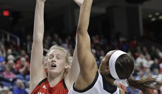 Louisville's Asia Durr (25) shoots against North Carolina State's Elissa Cunane (33) during the first half of an NCAA college basketball game in the Atlantic Coast Conference women's tournament in Greensboro, N.C., Saturday, March 9, 2019. (AP Photo/Chuck Burton)